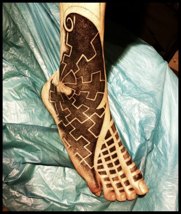 swastika_foot__wip_by_meatshop_tattoo-d5o004s