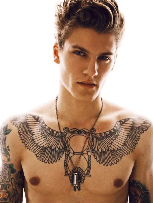 Guy with tattoos and piercings