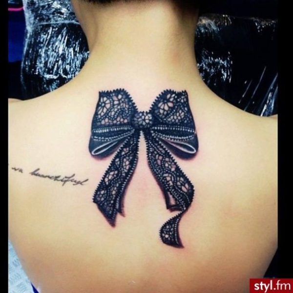Black lace bow tattoo