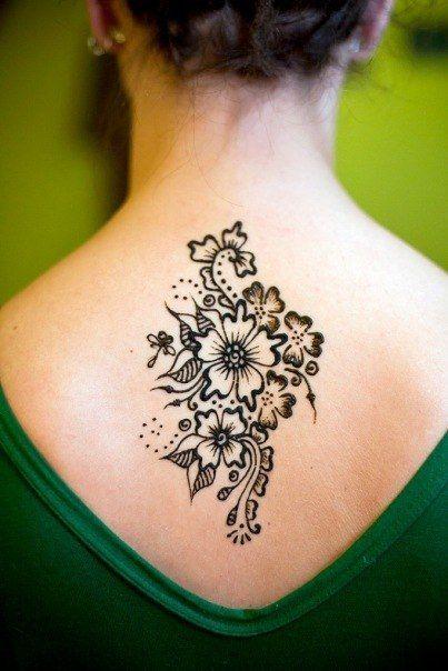 Back flowers tattoo for girls