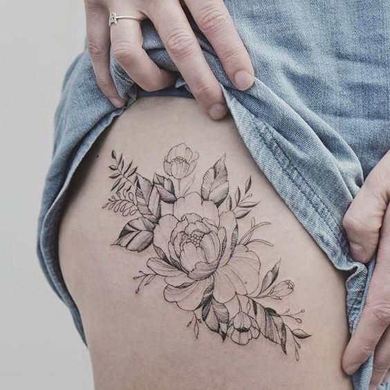 Delicate peonies on thigh