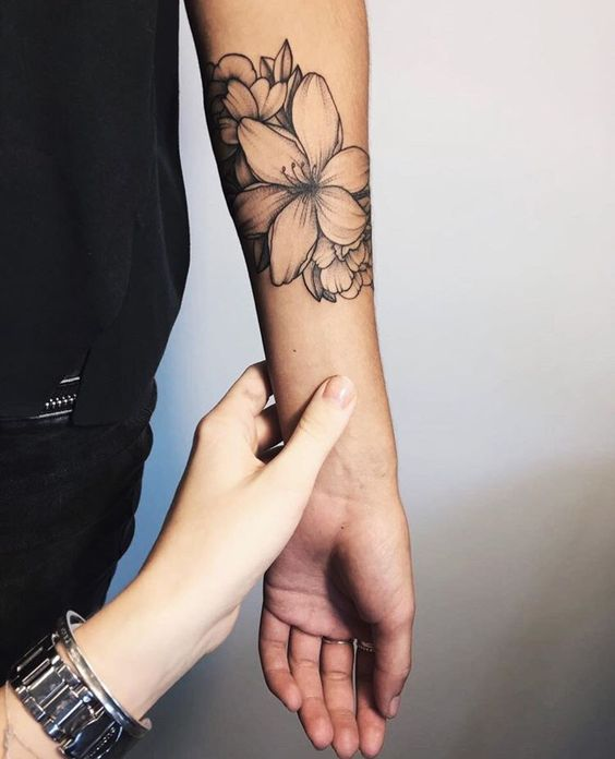Flawless Tattoo flower on arm
